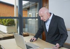 A business man in office. A business man in an office works at the computer Stock Images