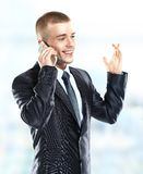 Business man at the office building on phone Royalty Free Stock Photos