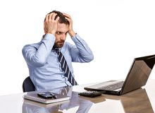 Business man in office with burnout syndrome at desk Stock Photography