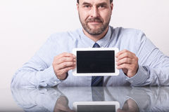 Business man on office desk, showing tablet computer with empty Stock Photos