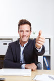 Business man in office holding Royalty Free Stock Photo