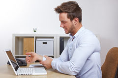 Business man in office with RSI royalty free stock photo
