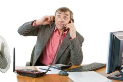 A business man in an office works Stock Images