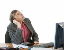 A business man in an office works Stock Photography