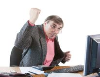 A business man in an office works Royalty Free Stock Photos