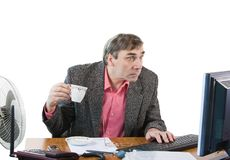 A business man in an office works Stock Image