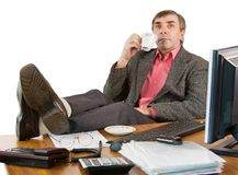 A business man in an office works Royalty Free Stock Photo