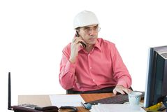 A business man in an office works Royalty Free Stock Images