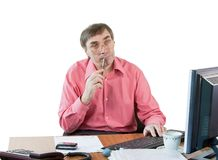 A business man in an office works Royalty Free Stock Photography