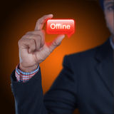 Business man with offline button Royalty Free Stock Photo