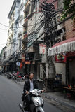 Business man in Old Quarter in Hanoi, Vietnam. Hanoi Old Quarter, street and traffic with a lot of motorbike and people Royalty Free Stock Photography