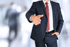 A business man with an open hand extended to handshake Stock Image