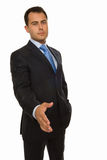Business man with an open hand ready for a hands. A business man with an open hand ready for a handshake Royalty Free Stock Images