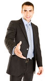 Business man with an open hand ready for a handsha Stock Photography