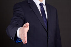 Business man with open hand ready to handshake Stock Image