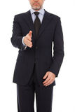 A business man with an open hand ready to seal a d. Business man extending hand to shake Royalty Free Stock Photo
