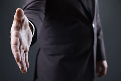 Business man with open hand ready to seal deal Stock Images