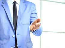 A business man with an open hand Stock Photo