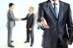 Business man with an open hand ready to seal a deal Stock Photo