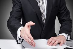 Business man open hand ready to seal a deal, partner shaking hands, in the office Royalty Free Stock Photos