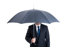 Business man with an open umbrella Stock Images