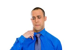 Business man opening shirt to vent Stock Images