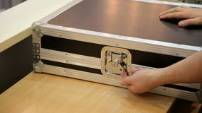 Business man opens an aluminum briefcase. Close-up of man hand opens suitcase combination lock stock video