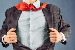 Business man opens his jacket. Space for text, face is visible Stock Image
