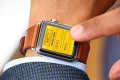 Business man ordering food through a smart watch app Royalty Free Stock Photo