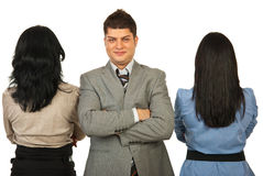 Business man out of crowd. Business men with arms folded standing out of crowd isolated onw hite background Royalty Free Stock Image