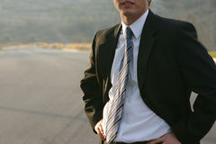 Business man outdoors. Young business executive royalty free stock photography