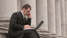 Business man Outdoors Using Laptop Stock Images