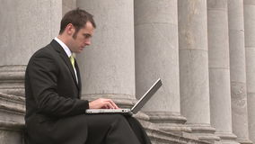 Business man Outdoors Using Laptop Royalty Free Stock Images