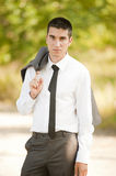 Business man outside. Portrait of a young business man in park Royalty Free Stock Photo