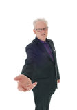 Business man with outstretched hand. A senior business man standing in a suit and glasses with a welcome Stock Photo