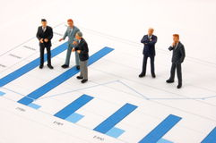 Business man over economic chart Stock Image