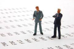 Business man over economic chart Royalty Free Stock Photo