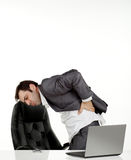 Business man in pain. Business man in his office in pain holding his back Royalty Free Stock Images