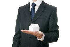 Business man with a paper house in the hand Royalty Free Stock Photo
