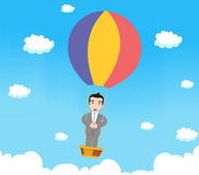 Business man with parachute Stock Photography