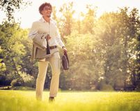 Business man at park. royalty free stock photos