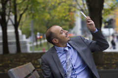 Business man in the park Stock Photography
