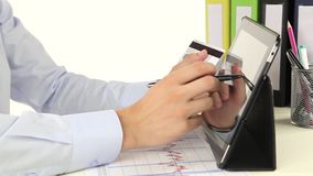 Business man paying with credit card by tablet. stock video
