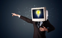 Business man with a pc monitor head and idea light bulb in the d Royalty Free Stock Image