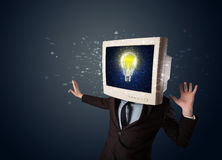 Business man with a pc monitor head and idea light bulb in the d Stock Photo