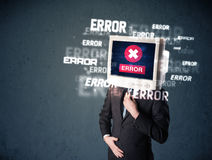 Business man with pc monitor on his head and error messages on t Royalty Free Stock Images