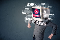 Business man with pc monitor on his head and error messages on t Royalty Free Stock Photos