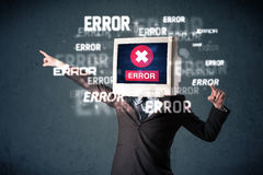 Business man with pc monitor on his head and error messages on t Royalty Free Stock Photo
