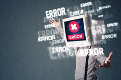 Business man with pc monitor on his head and error messages on t Stock Photo