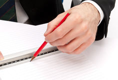 Business man with pencil and ruler stock photos